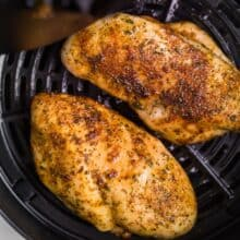 air fryer chicken breast in basket of air fryer