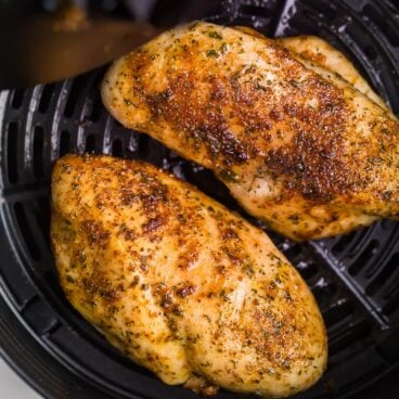 air fryer chicken breast in basket of air fryer