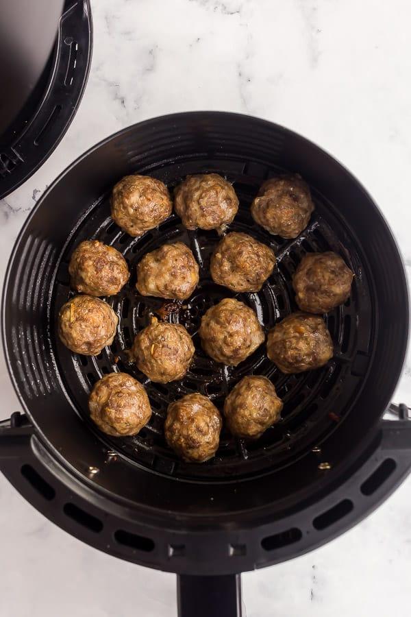 overhead image of air fryer meatballs in air fryer basket