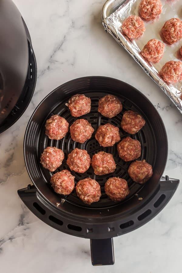 raw meatballs in air fryer basket