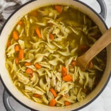 overhead image of chicken noodle soup in dutch oven