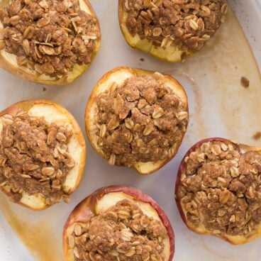 overhead image of halved baked apples with streusel