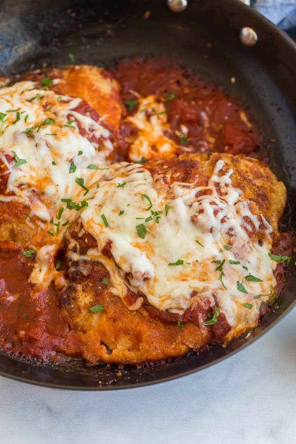 close up image of chicken parmesan in pan