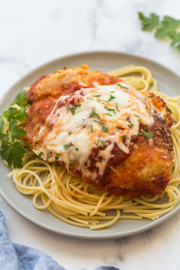 chicken parmesan on plate with spaghetti