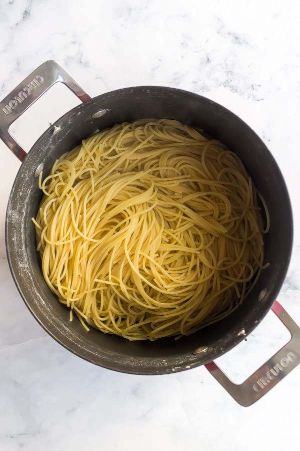 large pot with cooked spaghetti in it