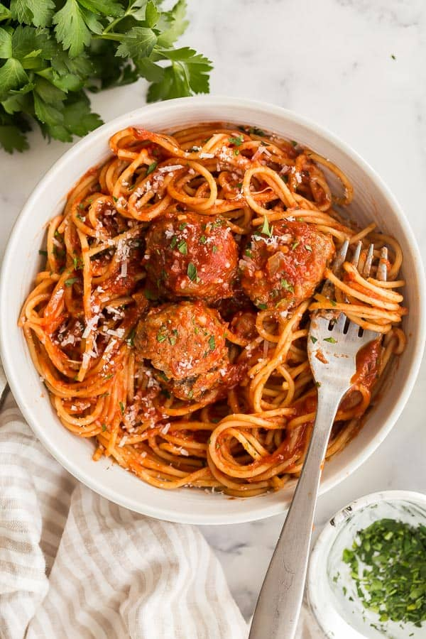 overhead image of spaghetti and meatballs in white bowl