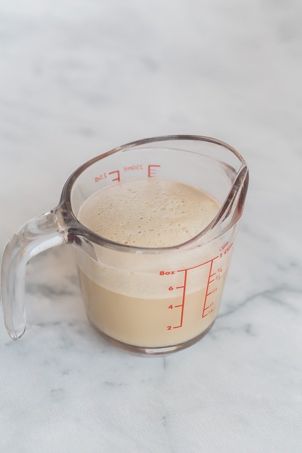 activated yeast in warm water in glass measuring cup