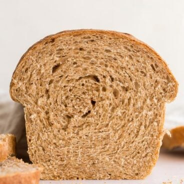 close up of whole wheat bread loaf sliced open