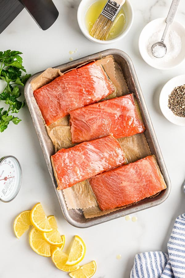 overhead image of uncooked salmon fillets on sheet pan