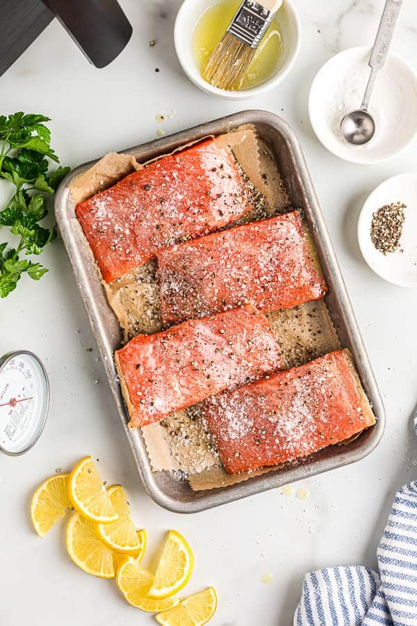 salmon fillets with seasoning on sheet pan