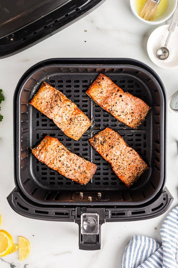 cooked salmon fillets in air fryer basket