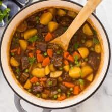 overhead image of beef stew in dutch oven