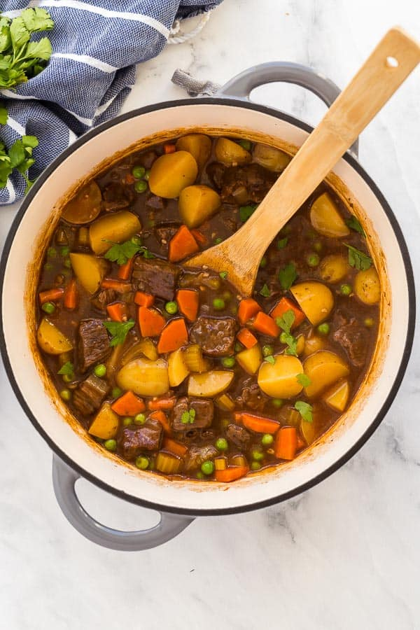 overhead image of beef stew in dutch oven