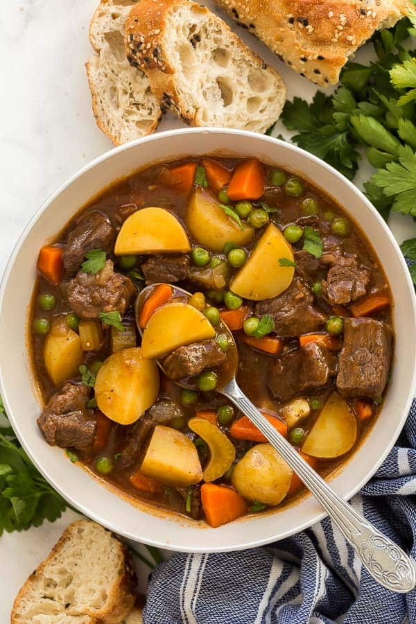 overhead image of beef stew in bowl with spoon