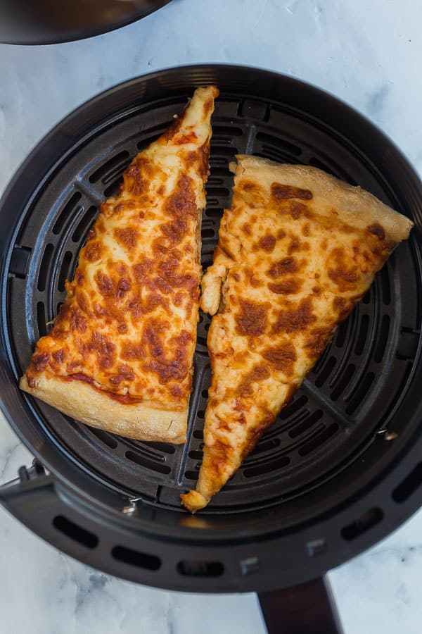 leftover pizza slices in air fryer basket
