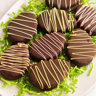 chocolate coated reeses easter eggs on white platter