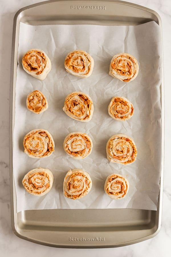 unbaked pizza rolls on baking sheet