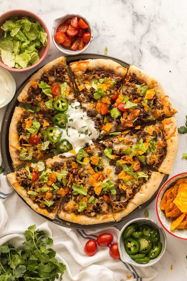 overhead image of taco pizza sliced