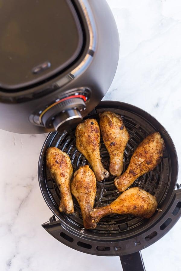 cooked chicken legs in air fryer basket