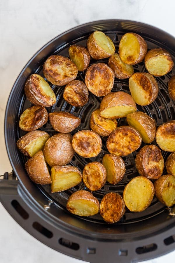 close up of cooked air fryer potatoes in basket