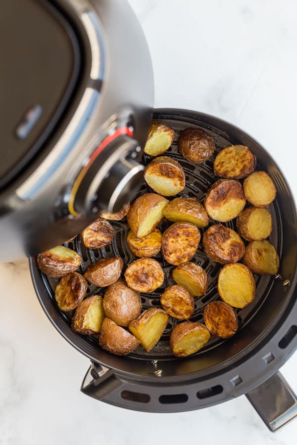 cooked potatoes in air fryer basket