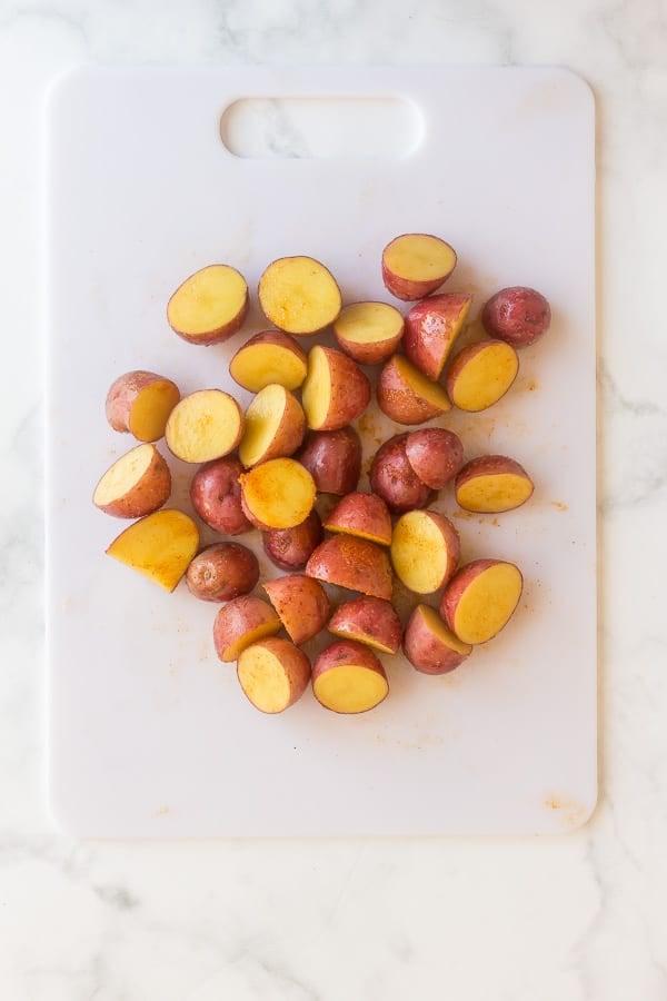 seasoned potatoes on cutting board