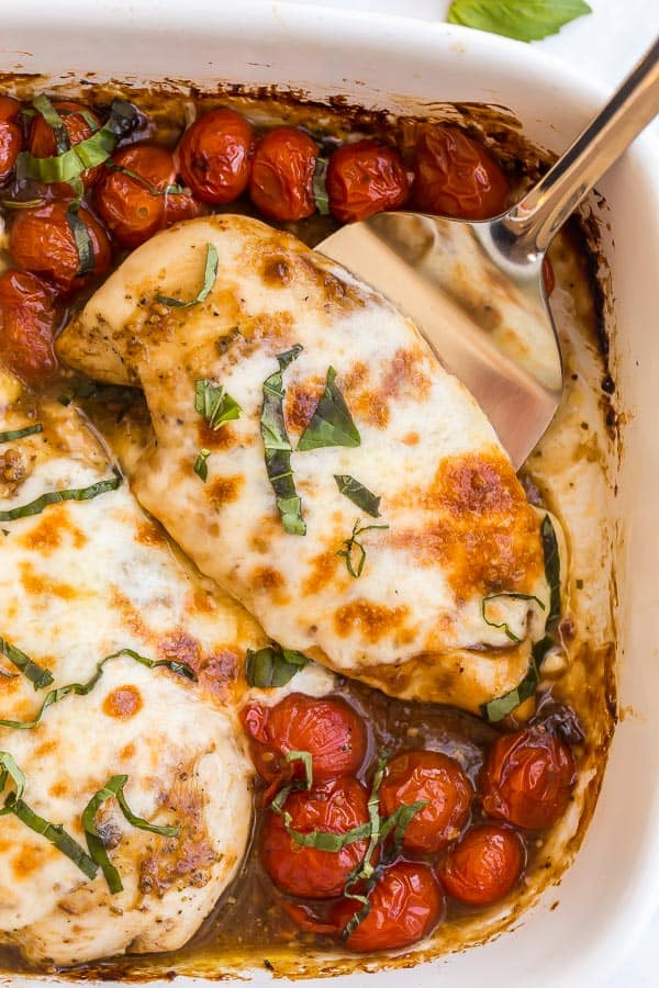 close up of caprese chicken in baking dish