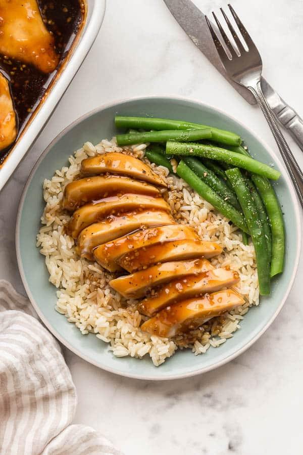 sliced honey garlic chicken on plate with rice