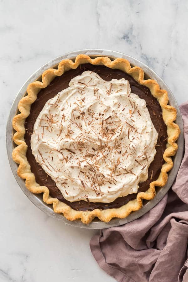 overhead image of chocolate cream pie with whipped cream and chocolate shavings