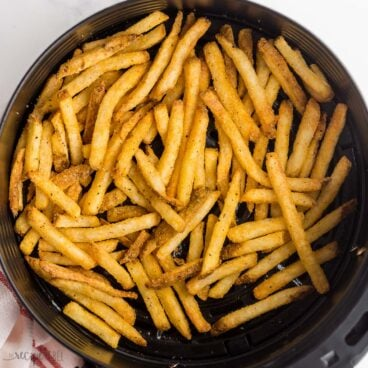 overhead image of french fries in air fryer