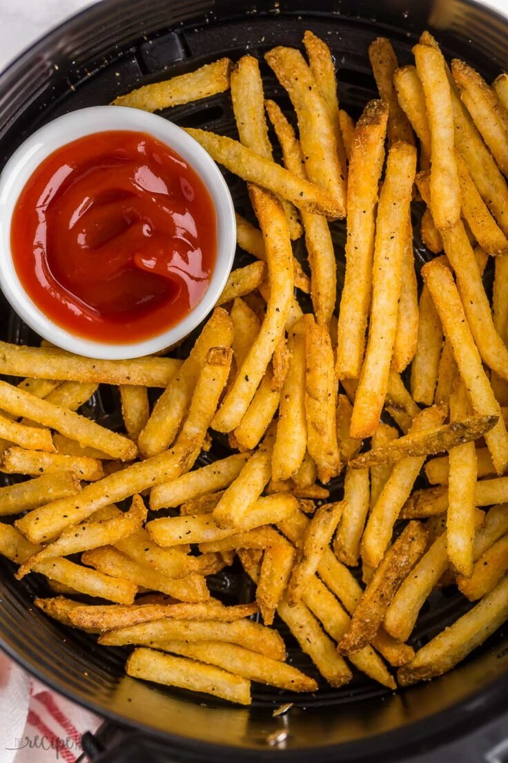 overhead image of air fryer frozen french fries in basket