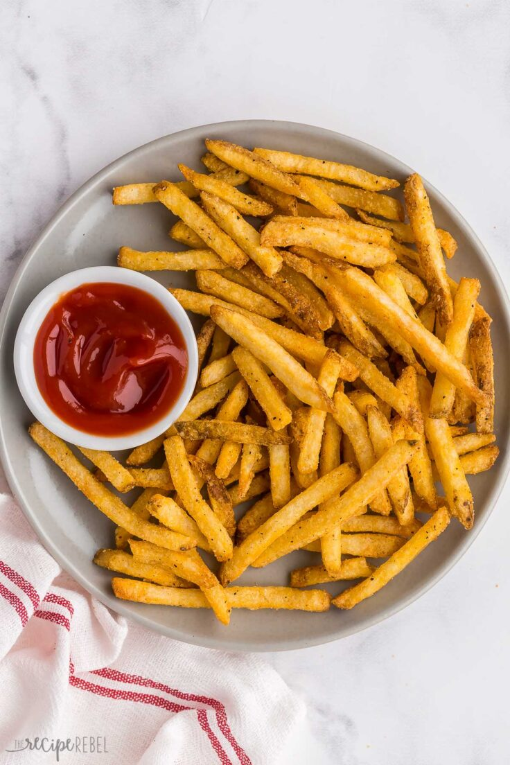 crispy air fryer french fries on grey plate