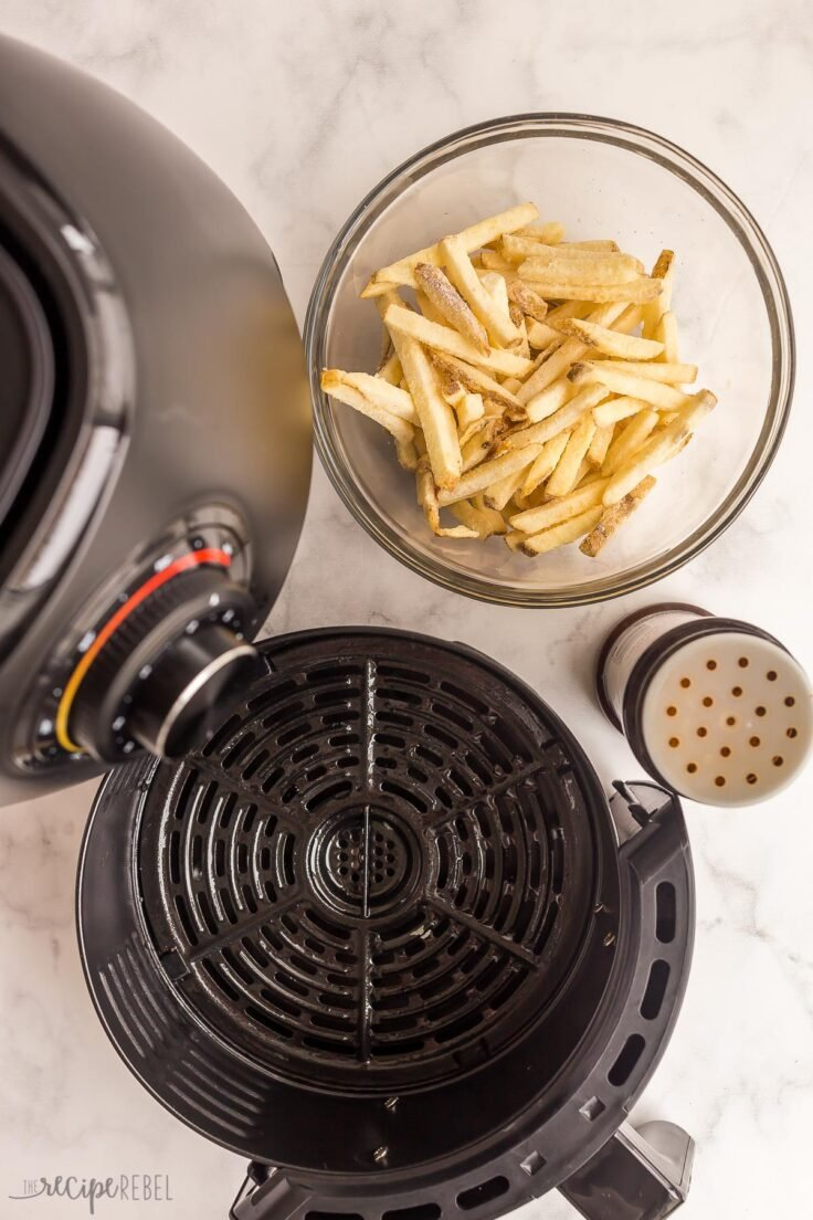 frozen french fries in bowl ready to go in air fryer