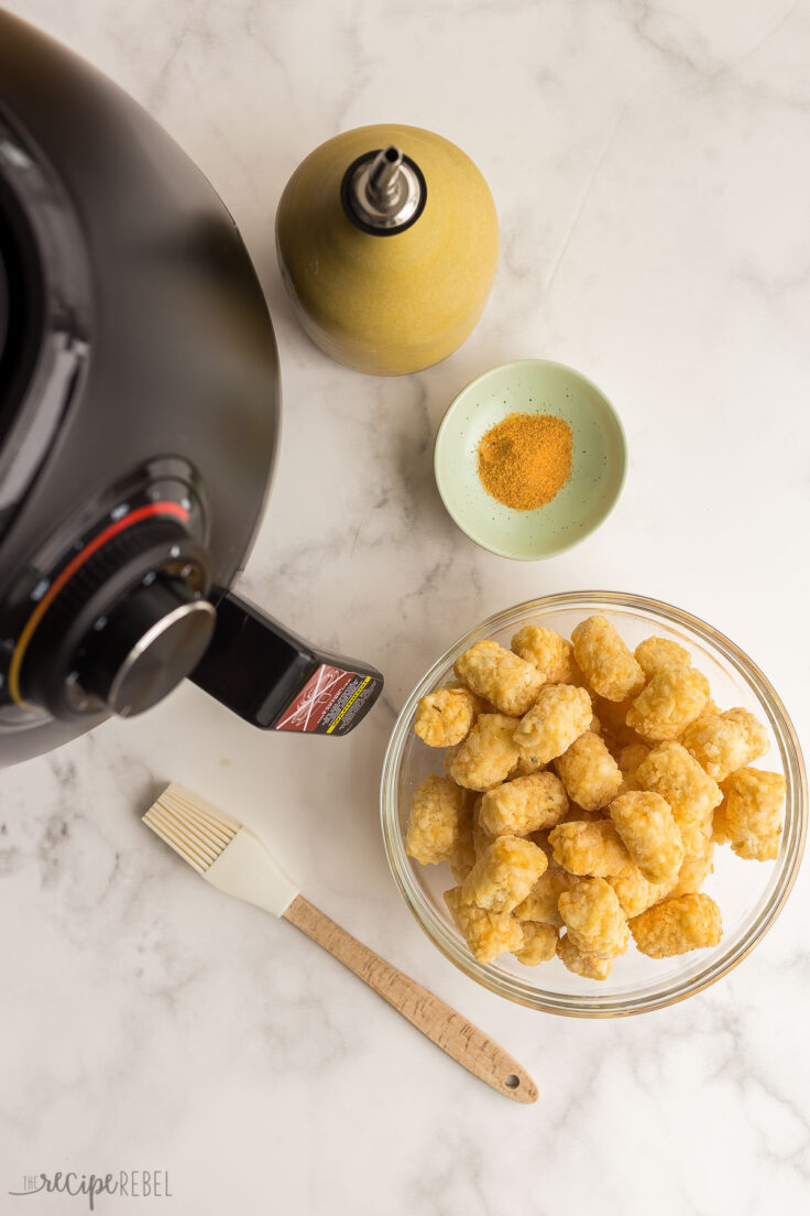 frozen tater tots with oil and seasoning salt