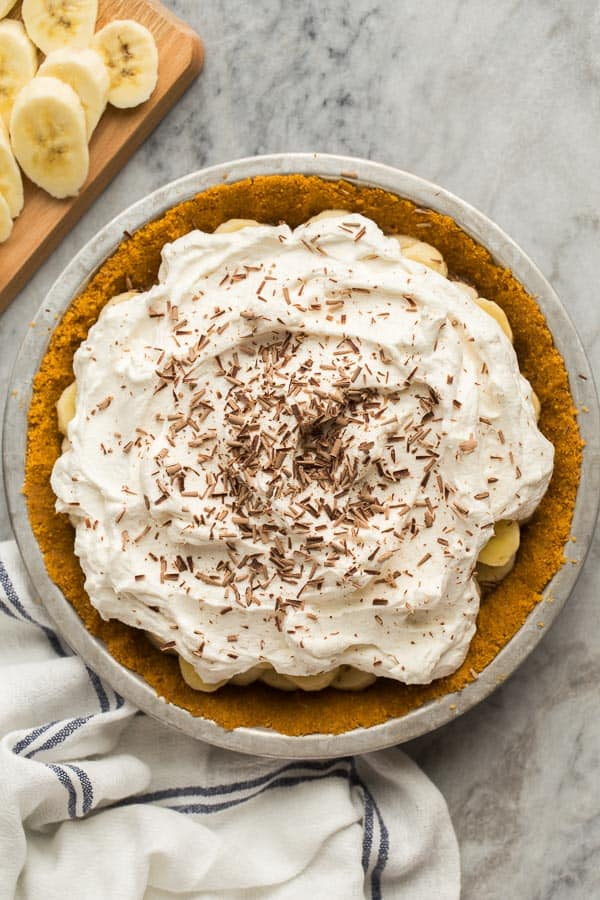 overhead image of banoffee pie on marble background