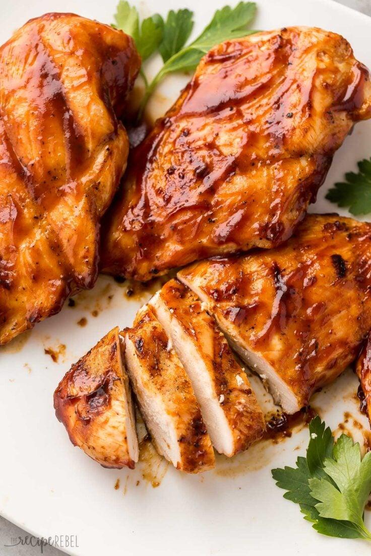 sliced bbq chicken breast on white plate