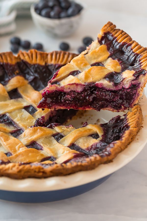 slice of blueberry pie being lifted out of pan