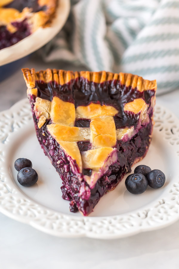 slice of blueberry pie on white plate