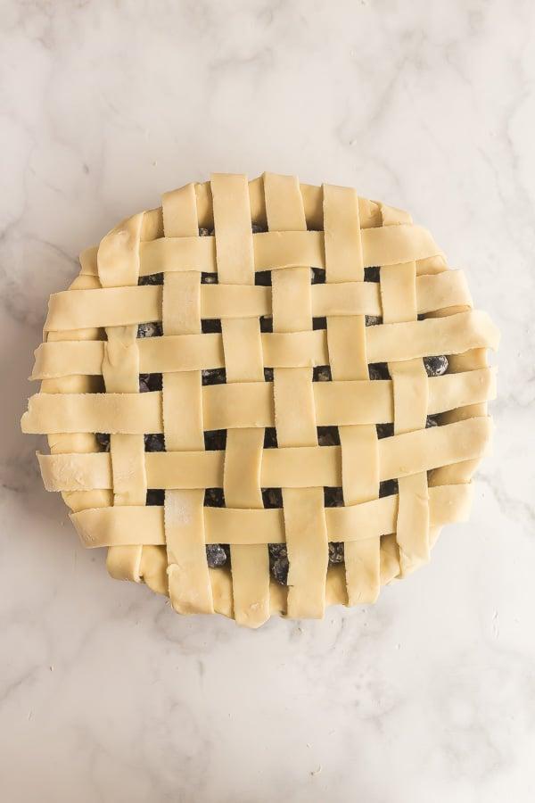 overhead image of blueberry pie with lattice pie crust uncooked