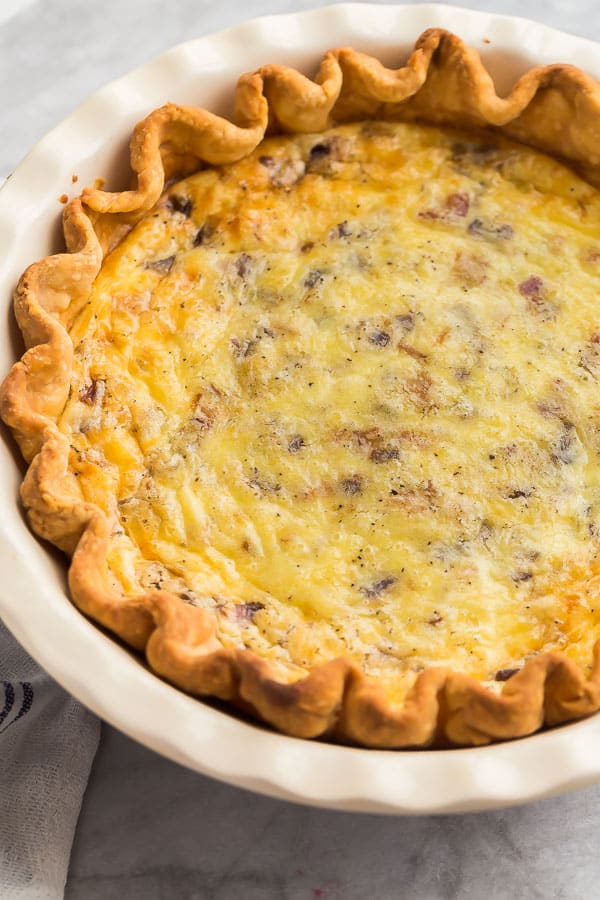 close up image of quiche lorraine in pie plate
