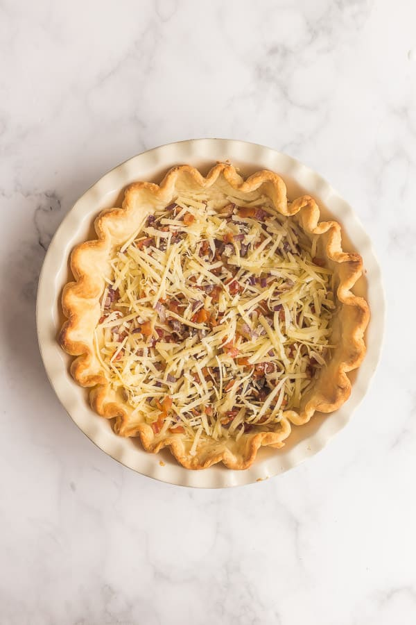 blind baked pie crust with bacon onions and cheese in it