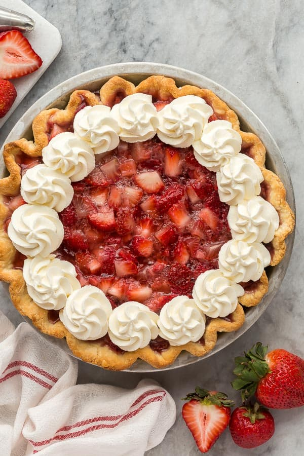 overhead image of fresh strawberry pie with whipped cream