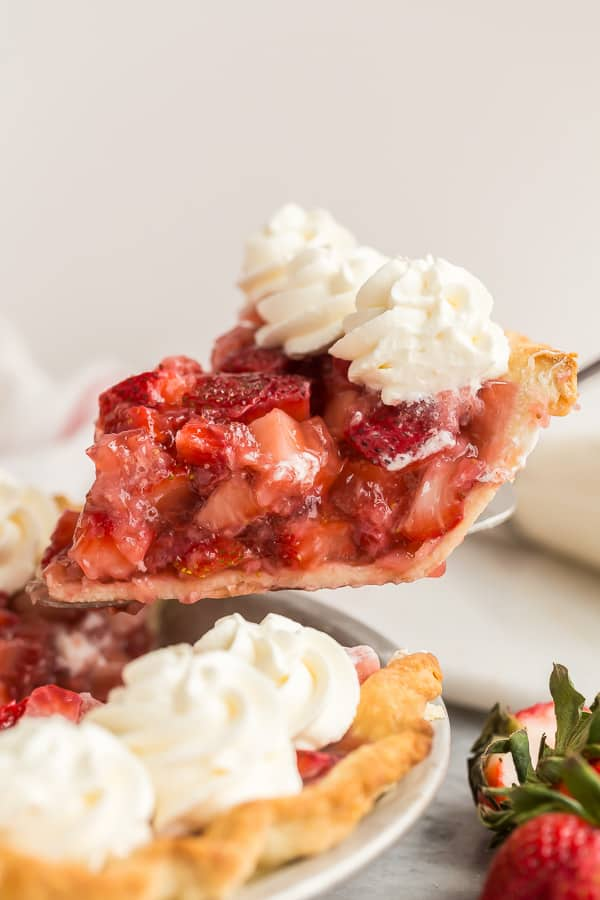 slice of strawberry pie being lifted out of whole pie