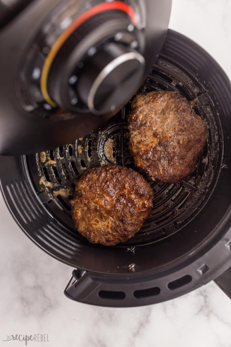 cooked burgers coming out of air fryer