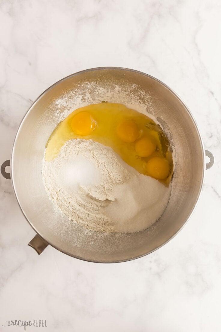 flour sugar salt and eggs in mixing bowl