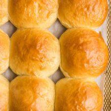 close up image of brioche buns on baking sheet