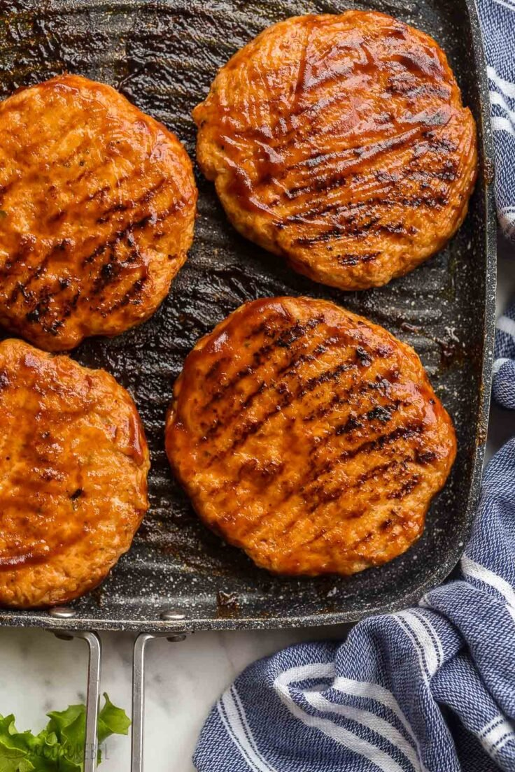 close up image of grilled chicken burger patties