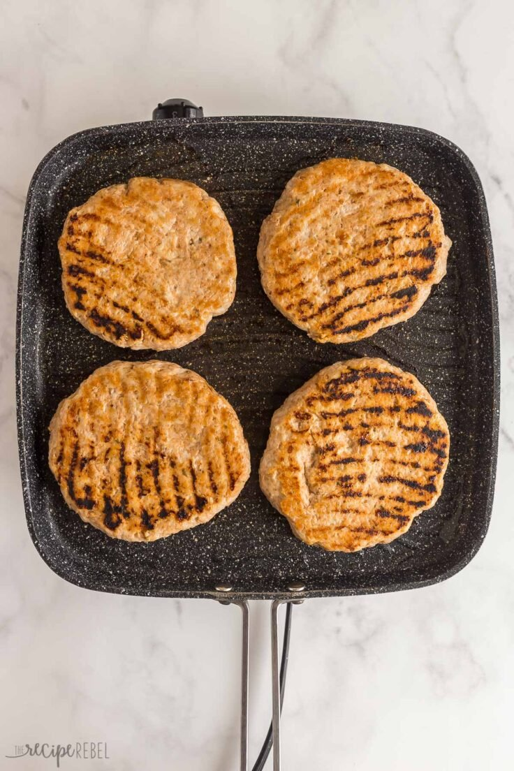 cooked chicken burgers on grill pan