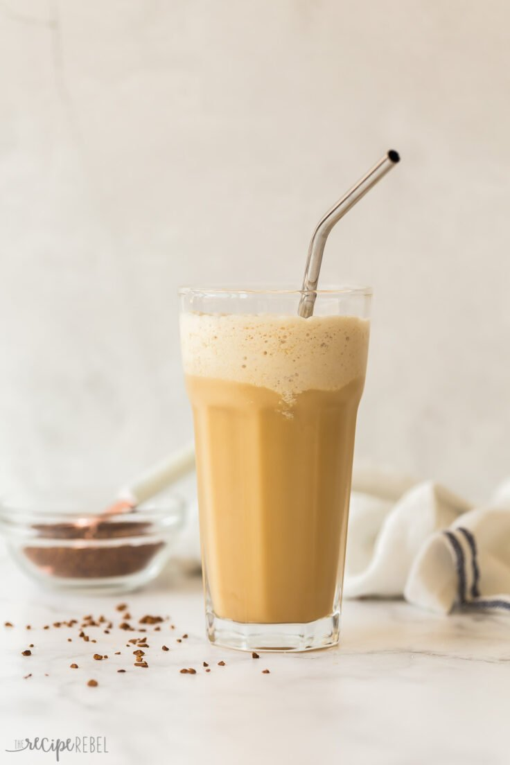 tall glass of blended frappe with instant coffee in the background