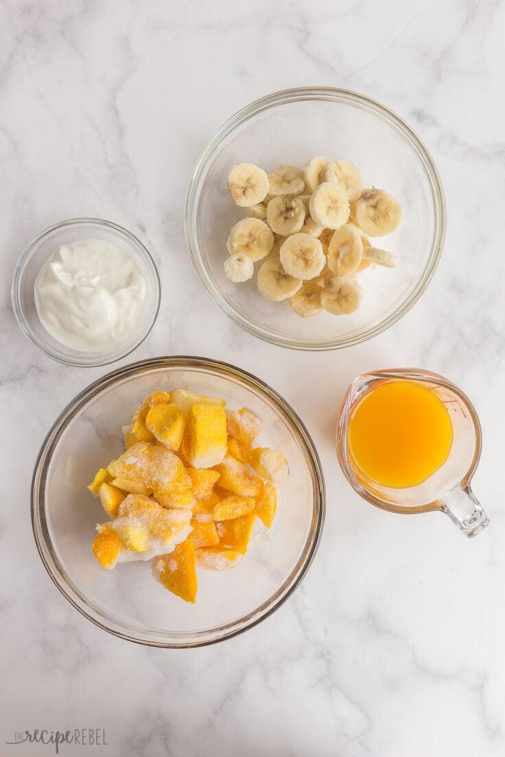 overhead image of mango smoothie ingredients
